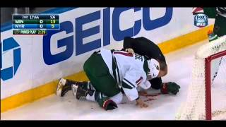 Zach Parise takes high stick from Mark Staal 10/27/14