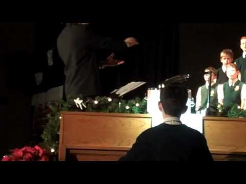 Jared Hasson playing the piano at the Timpanogos Academy Christmas program.