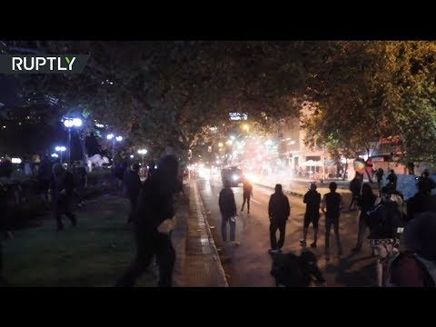 Chilean police use teargas & water cannons to disperse protestors for rights of indigenous people