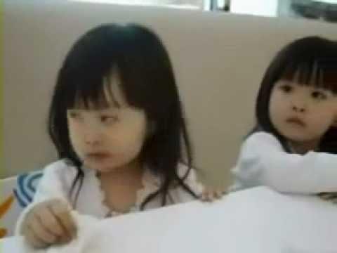 Cute Asian girls Kids Kissing