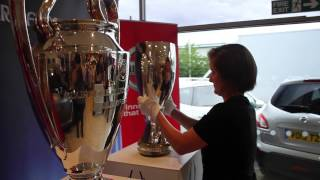 UEFA Super Cup and UEFA Champions League trophies