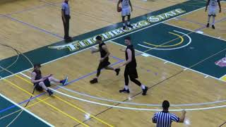 College basketball player knocks out opponent with elbow