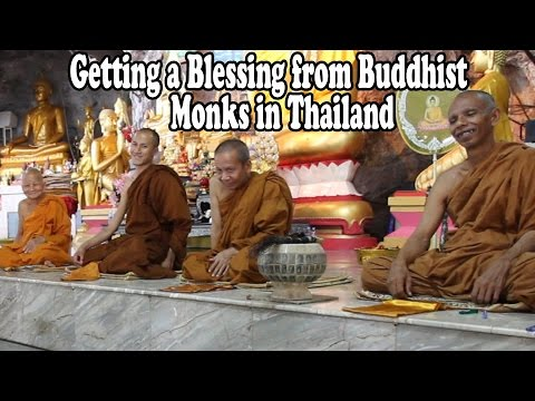 Getting a Blessing from Buddhist Monks in Thailand.