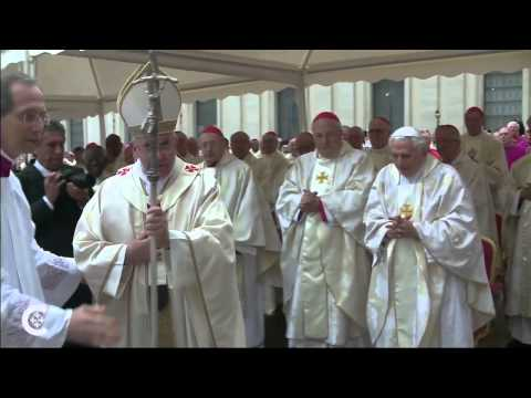 Pope greets pope at canonization