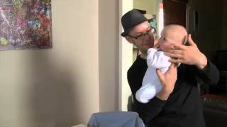 Dads handling and holding a newborn baby