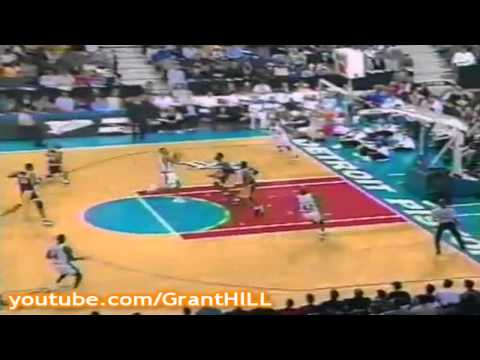 A prime Grant Hill soars just inside the free throw line all the way to the hoop!