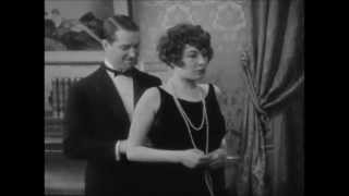 Yola d'Avril Shows Her Garters To Maurice Chevalier