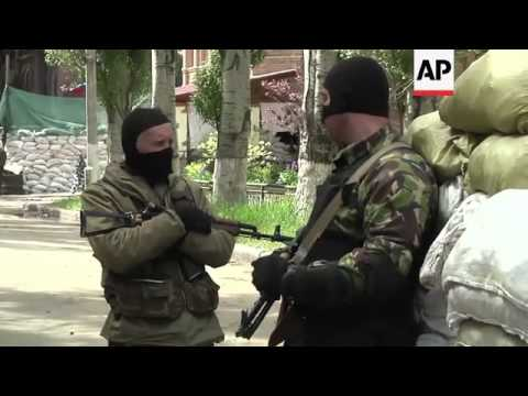 Pro-Russian militias set up barricades outiside building used as military headquarters