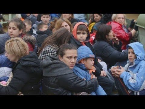 Balkan floods: 37 dead and thousands flee Bosnia, Serbia floods