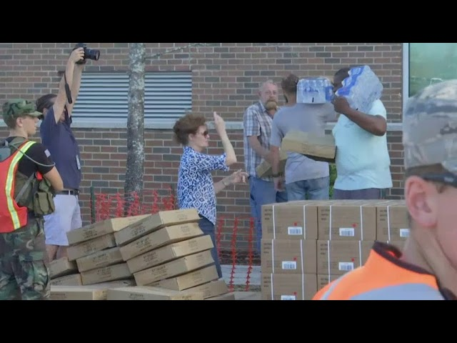 Wilmington residents line up for water, food