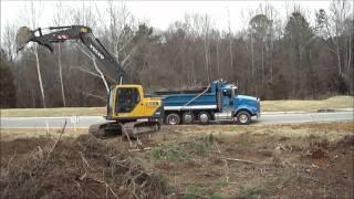 Volvo 140BL Excavator Loading Brush