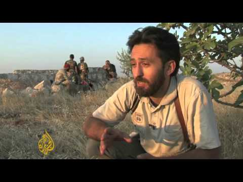 Rebels clash with Syrian army over suburbs