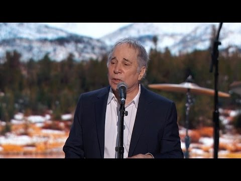 Paul Simon Faces Backlash For Lackluster DNC Performance