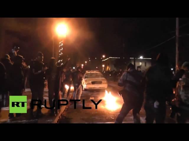 Ferguson protesters attack, overturn police cruiser