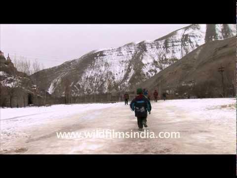 Children skating on Ice, Ladakh