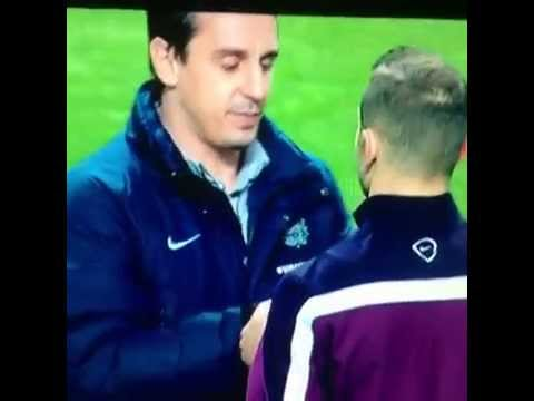 Gary Neville telling Jack Wilshere to take his earphones out Scotland - England