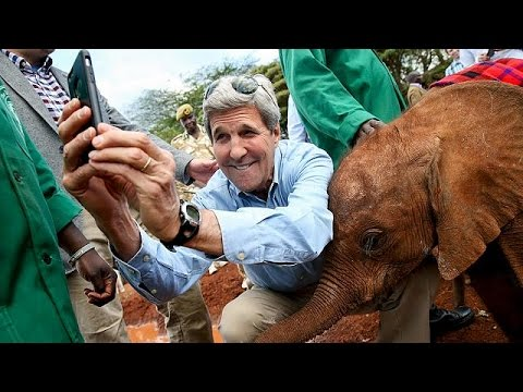John Kerry's 'selfie' pose with baby elephant in Kenya