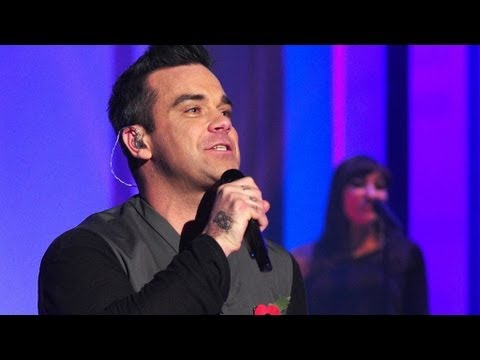 "http://www.bbc.co.uk/programmes/b01nqvfr Robbie Williams performs his new single ""Candy"" with the help of the studio audience."