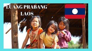 LAOS, WALKING through a graphic RURAL VILLAGE in LUANG PRABANG, amazing views
