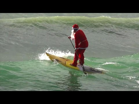 Santa Claus surfing near Genoa