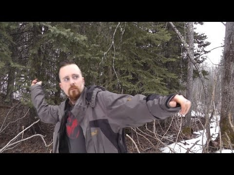 Practicing axe throwing with the SOG Fasthawk