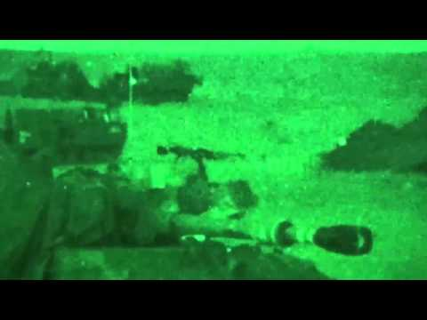 Night vision footage shows Israeli army cannons firing at Gaza