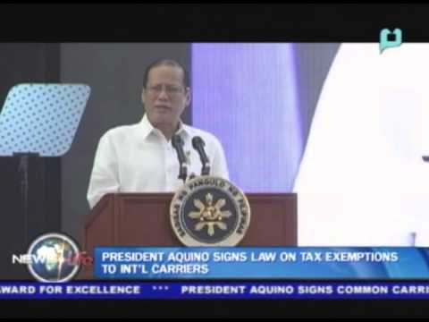 President Aquino signs law on tax exemptions to int'l carriers