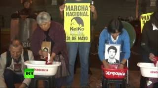 Activists wash Peruvian flags in 'democracy' bucket to protest Fujimori's presidential campaign