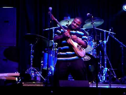 Tyree Neal plays with Kenny Neal's right hand guitar, upside down with his left hand