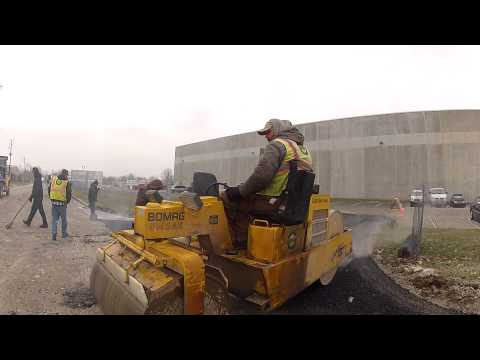 Globe Paving paves Planes Moving & Storage of Indianapolis's new entrance December 2014