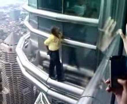 French Spiderman Scaling Petronas Twin Towers Video