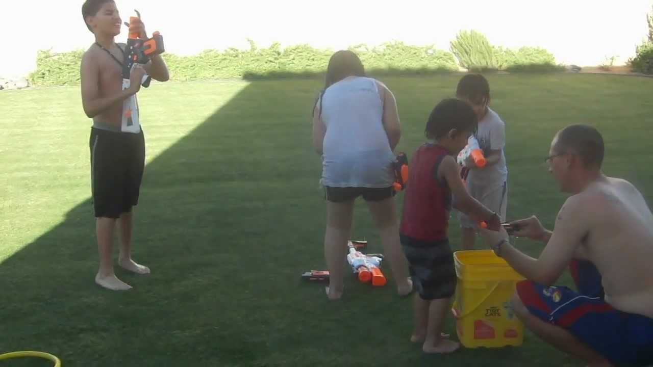 Kids playing in the yard with water. - YouTube