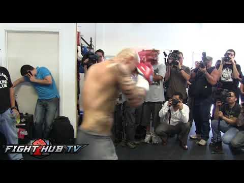 Miguel Cotto vs. Delvin Rodriguez- Cotto hits speed bag w/Freddie Roach Image 1