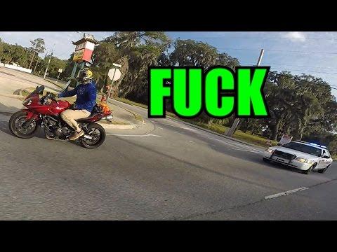 Biker Does Wheelie In Front Of Cop!