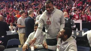 Quinnen Williams, Raekwon Davis, and Terrell Hall compete flipping water bottles