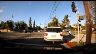 Car runs red light and hits girl on bike.. Pursuit follows