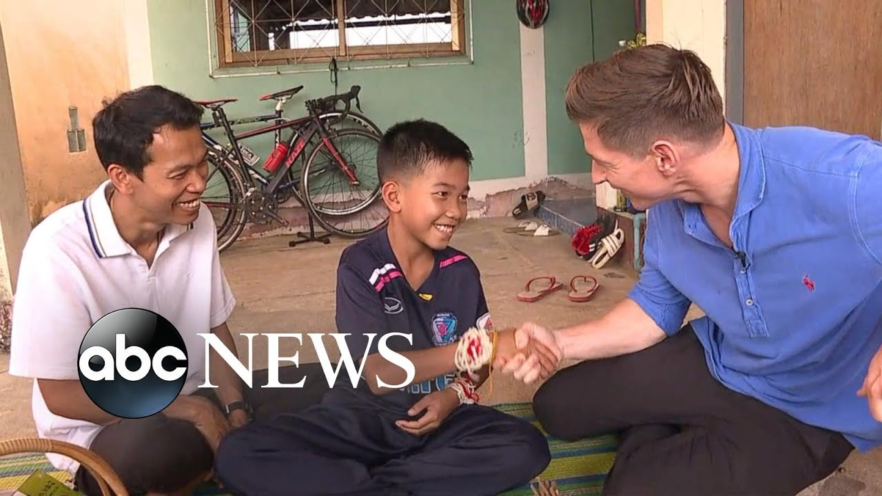 11-year-old Thai soccer player held onto coach's back during rescue