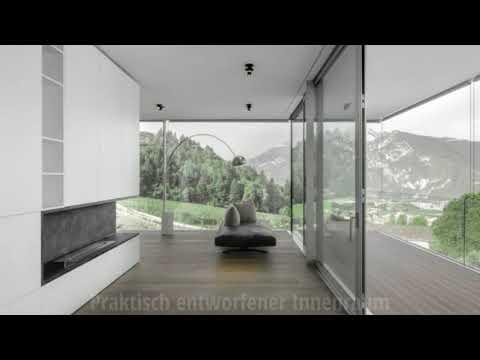 Ein Sichtbeton Haus beeindruckt mit einfachen Formen und Architektur