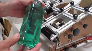 97 RLTC-SP RACE Label Applicator Applying front and back labels to square plastic juice bottle