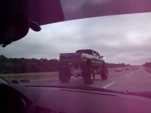 Huge Monster Truck driving on a highway alongside my car ...