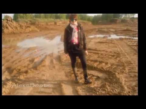 Girl Eugene walking in rubber boots with heels in the mud.
