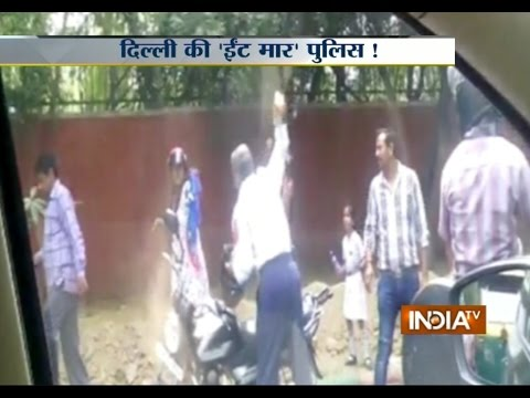 Shocking! Delhi Traffic Constable Hits Woman with a Brick - India TV
