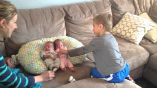 Brother meets triplet siblings for the first time! 2 in the video, 3rd came home two days later.