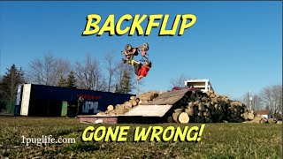BACKFLIP OVER THE WOOD PILE!!! OUCH!!!