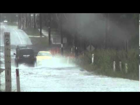 Ute Chases Small Sedan Through Water