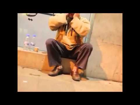 Homeless man reading Qur