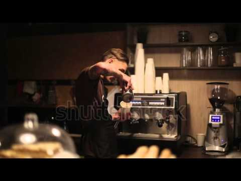 barista of coffee shop makes a cup of coffee for the visitor