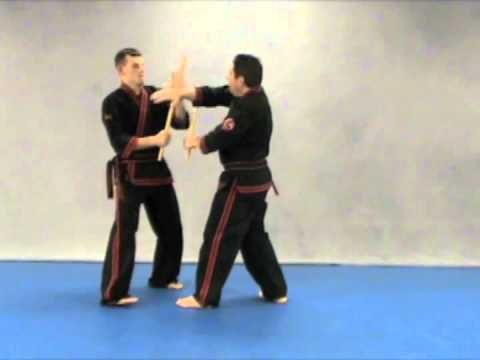 Modern arnis Ken Smith performing Kitchen sink move Image 1
