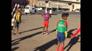 Ethiopia: Ethio-American Model Liya Kebede playing street soccer with Ethiopian teenage children