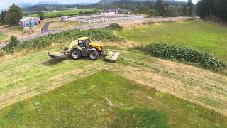 JCB 8310 with Claas triple mowers and mergers